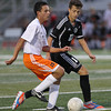Erik Anderson - For the Elburn Herald Kaneland's Arsim Azemi battles for possession of the ball against an opposing DeKalb player during the match up at DeKalb High School on Tuesday, September 17, 2013.