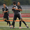 Erik Anderson - For the Elburn Herald Kaneland's Ignacio Toscano hugs team mate Arsim Azemi (10) after a goal during the match up at DeKalb High School on Tuesday, September 17, 2013.